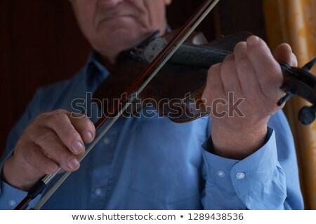 Senior Adult man playing violin Stock photo © IS2