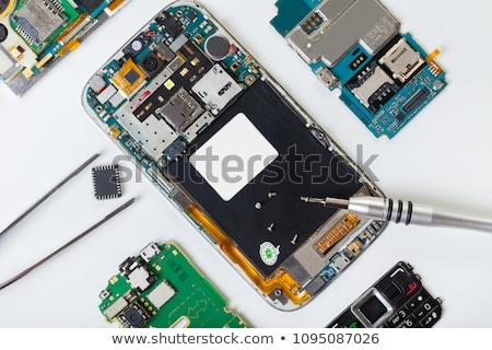 Téléphone portable tournevis haut vue téléphone Photo stock © OleksandrO