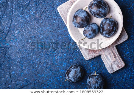 Fresh plums on marble cutting board Stock photo © Melnyk