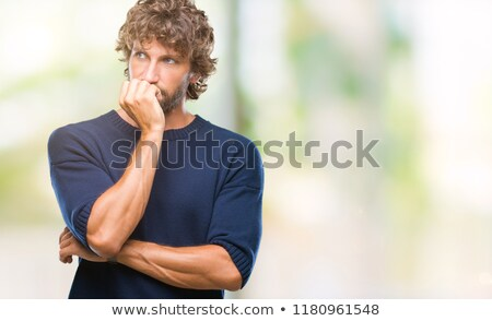Worried young man biting nails Stock photo © ichiosea