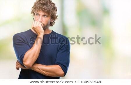 Worried young man biting nails Stock photo © ichiosea