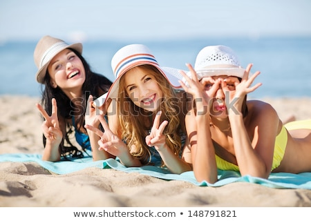 Attractive young girl in summer hat and swimwear Stock photo © deandrobot