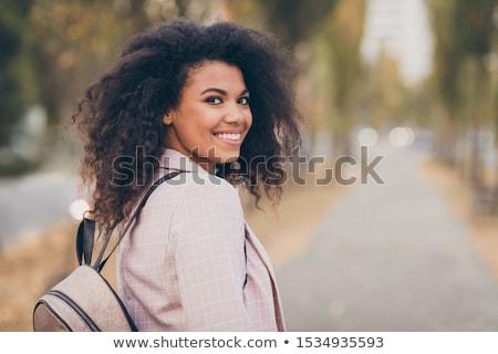 happy woman walking on a street in dreams stock photo © ichiosea