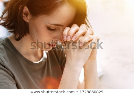 Young Woman Praying To God Stock photo © AndreyPopov