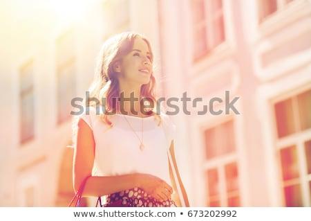 agradable · ejecutando · nina · jóvenes · deporte · auriculares - foto stock © dolgachov