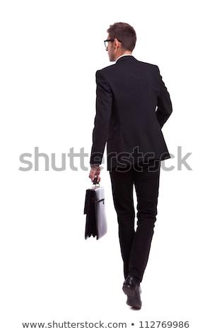 Elegancki biznesmen teczki stałego strona biały Zdjęcia stock © feedough