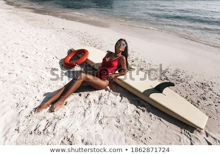 Suntanned Girl in Red Swimsuit with Surfboard Stock photo © robuart