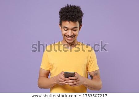 uśmiechnięty · młodych · mężczyzna · szczęśliwy · zakupy · online · komputera - zdjęcia stock © deandrobot