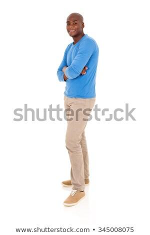 homem · bonito · óculos · de · sol · em · pé · cinza · parede - foto stock © feedough