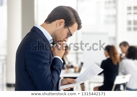 serious businessman waiting for job interview looks to side stock photo © feedough