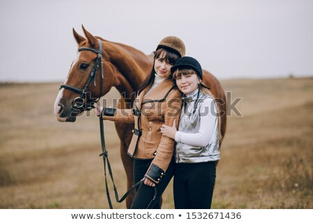 Beautiful and natural adult woman outdoors with horse Stock photo © Lopolo