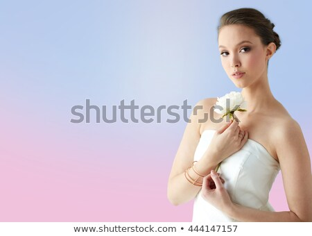 beautiful asian woman with flower and golden ring stock photo © dolgachov