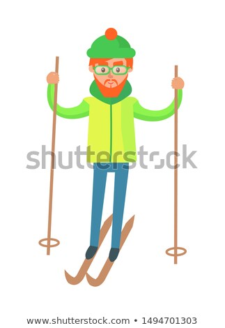 Male in Winter Gear, Riding on Skis with Ski Poles Stock photo © robuart