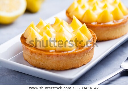 couple of sweet homemade lemon pies stock photo © mpessaris