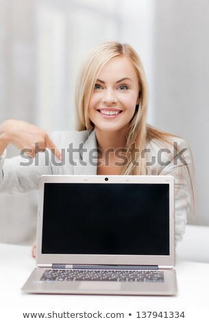 businessperson pointing finger on laptop screen stock photo © andreypopov