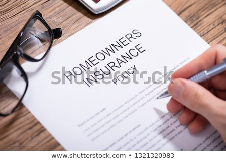person filling homeowners insurance policy form stock photo © andreypopov