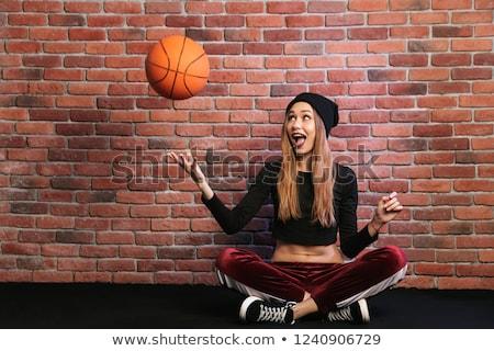Fotografia artystyczny dziewczyna 20s posiedzenia piętrze Zdjęcia stock © deandrobot