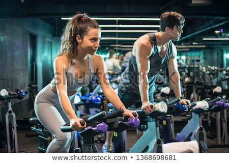 two friends cycling at gym stock photo © kzenon