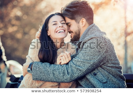 Young couple in love in a park Stock photo © Lopolo