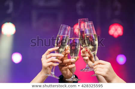 friends clinking glasses of champagne at party Stock photo © dolgachov
