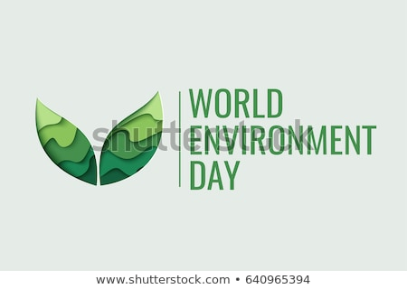 Earth Day card of paper cut leaves and world map Stock photo © cienpies