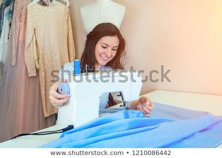 Alfaiate mulher trabalhando tecido trabalhar compras Foto stock © Kzenon