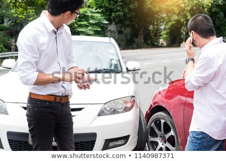 Teenage Driver Making Phone Calling to report car help assistanc Stock photo © snowing