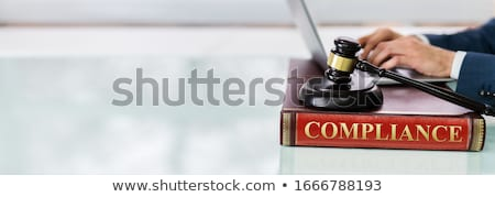 Foto stock: Judge Gavel And Soundboard On Compliance Law Book