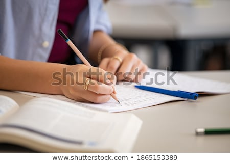 close up of studying student hands writing in book during lectur stock photo © freedomz