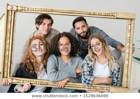 Group of young intercultural cheerful friends in casualwear looking at you Stock photo © pressmaster