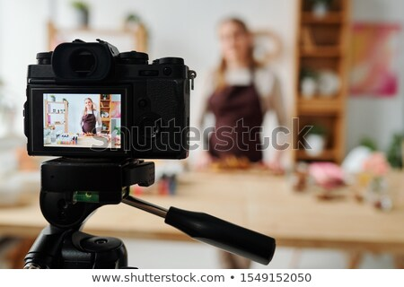 Contemporary girl on display of home camera recording soap making master class Stock photo © pressmaster