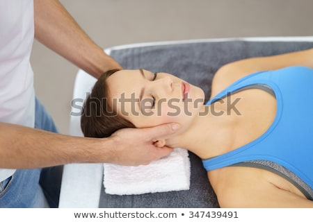 Neck and head massage in the physical therapy Stock photo © Kzenon