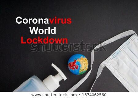 world globe with a mask and text stop coronavirus stock photo © nito