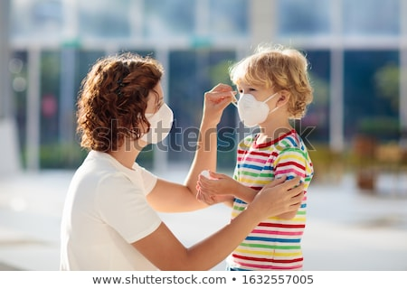Stock photo: Mother and child wearing facemasks