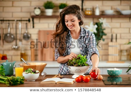 Woman, Housewife Cook Vegetable Salad in Kitchen Stock photo © robuart