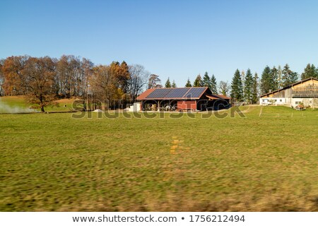 Farming lands and buildings with solar panels on the roof, Austria. Stock photo © artjazz