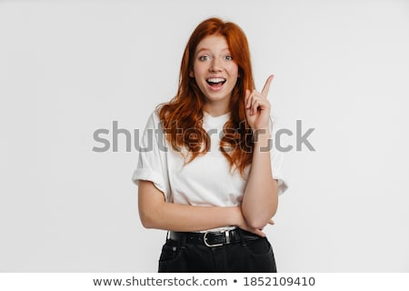 Obraz zachwycony kobieta wskazując palce Zdjęcia stock © deandrobot