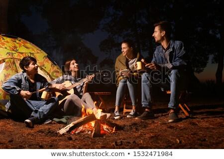 Kirándulás kempingezés tábortűz sátor játszik gitár Stock fotó © robuart