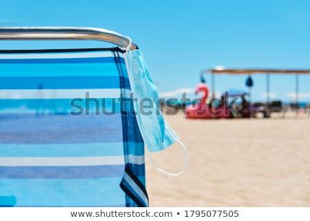 Mascarilla quirúrgica colgante cubierta silla playa primer plano Foto stock © nito