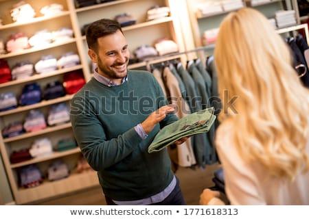 Jóképű fiatalember vásárol nadrág divat bolt Stock fotó © boggy