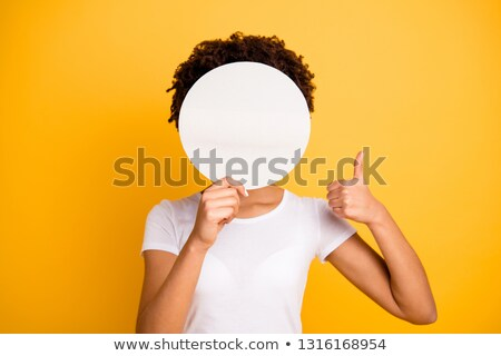 Image of multinational women showing thumbs up and holding placards Stock photo © deandrobot