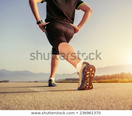 Atléta felfelé versenypálya visel fekete tréningruha Stock fotó © duoduo