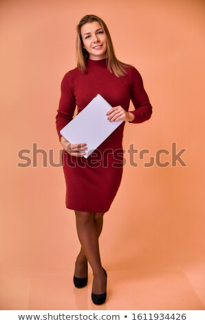 beautiful brown-haired woman stands with  red folder in hand Stock photo © Paha_L