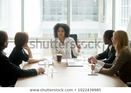 Attentive business woman Stock photo © lithian