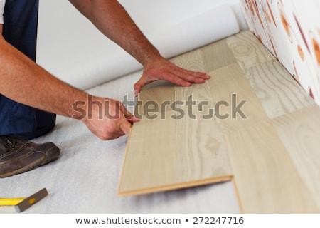 Man laying laminate flooring Stock photo © photography33