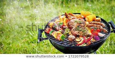 Barbecue főzés barbecue grill étel kéz fű Stock fotó © photocreo