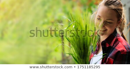 Closeup of a young woman kneeling in the grass Stock photo © photography33