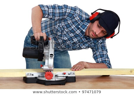 craftsman testing a new electric saw stock photo © photography33