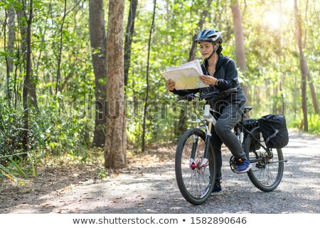 older woman looking at a map in a forest stock photo © photography33