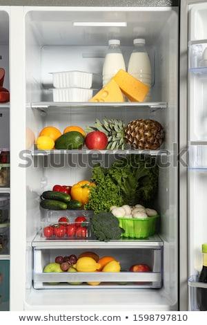 Completo geladeira comida pizza laranja morango Foto stock © glorcza